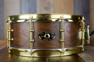 D L WALKER 14 X 5.5 SOLID SHELL WALNUT SNARE DRUM WITH GOLD HARDWARE (PRE-LOVED)