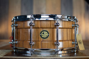 SIA 14 X 6.5 TEA TREE SOLID STAVE BARITONE BLOCK SHELL SNARE DRUM