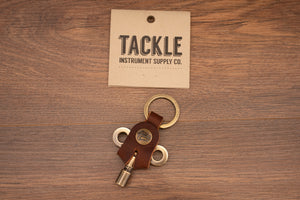 TACKLE TIMEKEEPERS DRUM KEY, MAHOGANY LEATHER, ANTIQUE BRASS KEY, SCRIPT BADGE