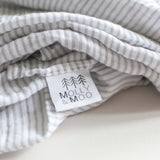 Organic muslin swaddle blanket in grey stripe