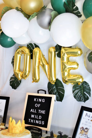 wild one first birthday party decorations with gold ONE balloons sold by sweet chubby cheeks