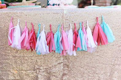 tissue paper tassel garland for dessert table in a mix of white, pinks, and aqua made by sweet chubby cheeks