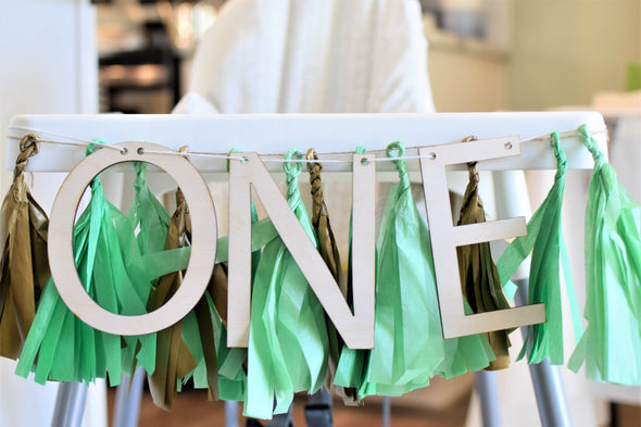 high chair banner for wild one first birthday by sweet chubby cheeks
