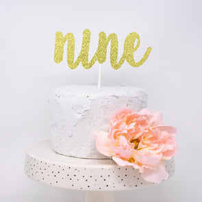 cursive nine cake topper for ninth birthday cake made by sweet chubby cheeks