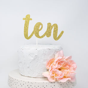 ten cake topper shown in gold, made by sweet chubby cheeks