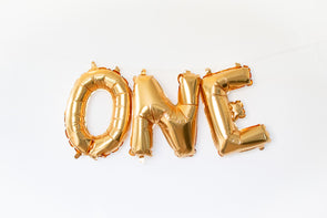 gold letter ONE balloons sold by sweet chubby cheeks