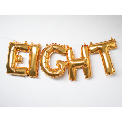 gold letter balloons spelling EIGHT by sweet chubby cheeks
