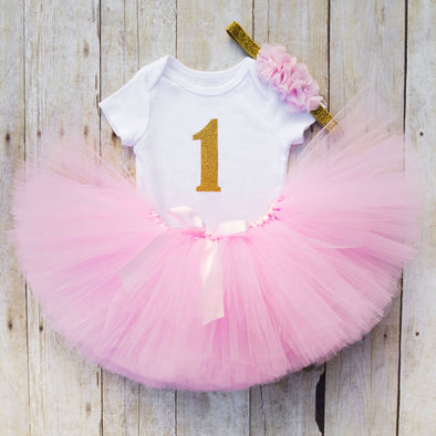 first birthday tutu set with light pink tutu and gold glitter bodysuit