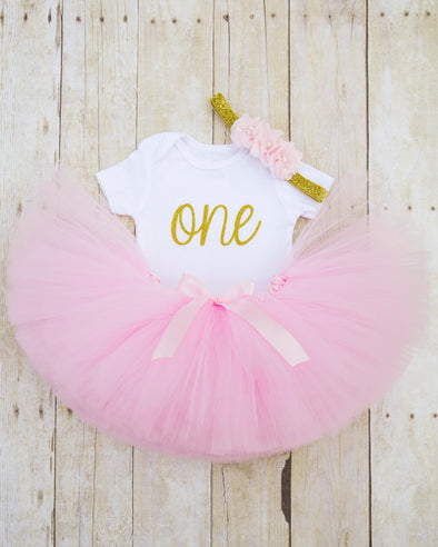 cursive one bodysuit in gold glitter with light pink tutu and matching headband