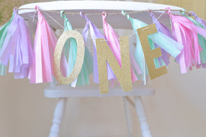 unicorn pastel color high chair banner and one glitter garland
