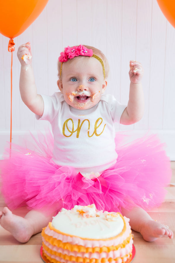 smash cake photo session in hot pink