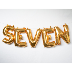 gold letter balloons spelling seven by sweet chubby cheeks