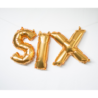 gold letter balloons spelling six by sweet chubby cheeks