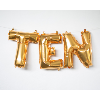 gold letter balloons spelling ten by sweet chubby cheeks
