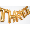 gold balloon letters spelling THREE sold by sweet chubby cheeks