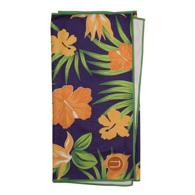 Large golf towel made of waffle microfiber with sublimation printed flower design on it and embroidery. Made by Uther Golf, the original fashionable printed golf towels. Stock design custom golf towels also available. Dark purple background of towel with orange floral and green leaves.