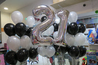 21 foil number and 40 helium balloons