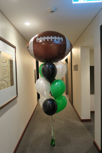 Foot ball helium balloon bouquet