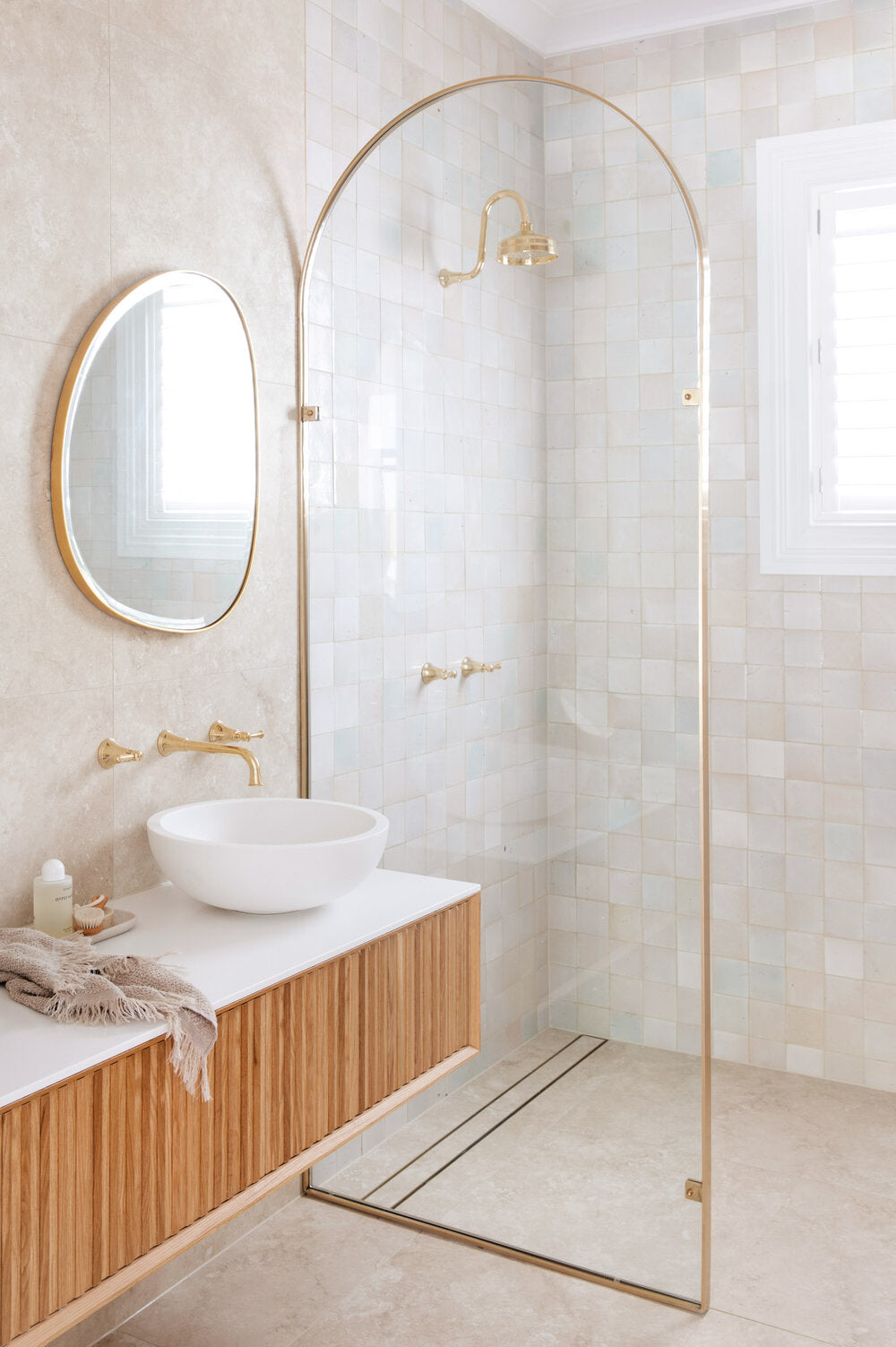 square tiled bathroom by three birds renovations