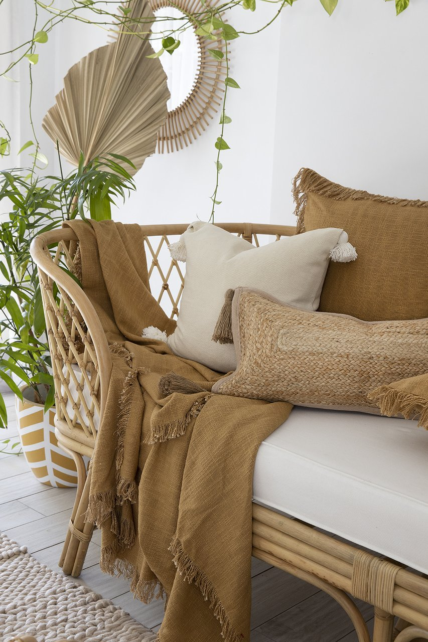 sea tribe throw blanket and cushions mustard