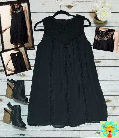A line dress with lace inset