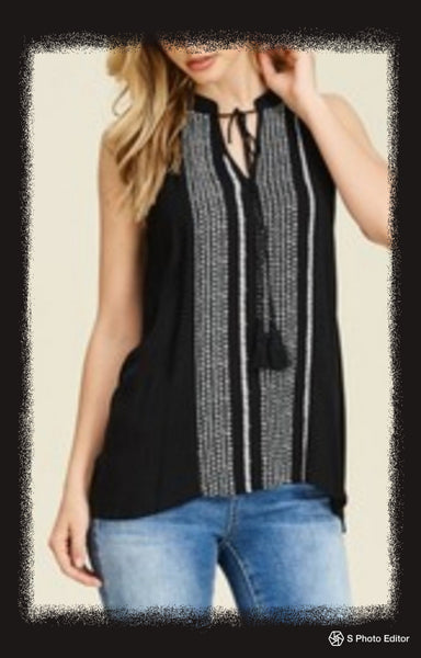Solid halter neck top with a tassel tie front and contrast stripe center detail