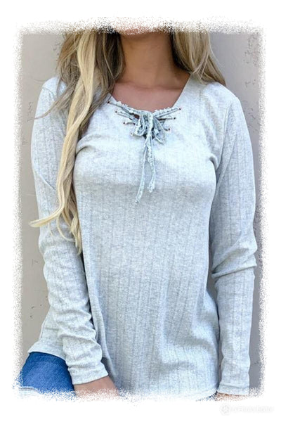 Long sleeve lace up front top
