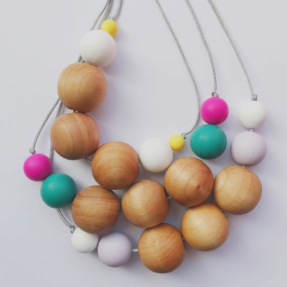 New summery colours in my maple teething necklaces!