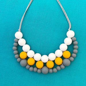 Silicone teething necklace: woven bib necklace (mustard)