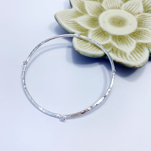 Silver hammered bangle - buds