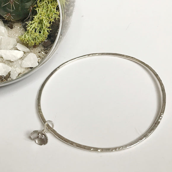 Silver hammered bangle - flora