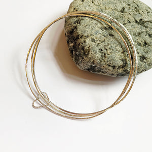 Silver bangle trio with heart or circle
