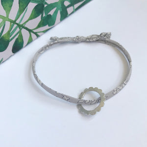 Liberty and silver bracelet: Capel petit gris with scalloped charm