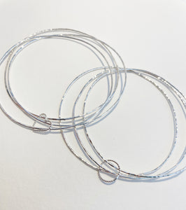 Delicate bangle trio with heart or circle charm