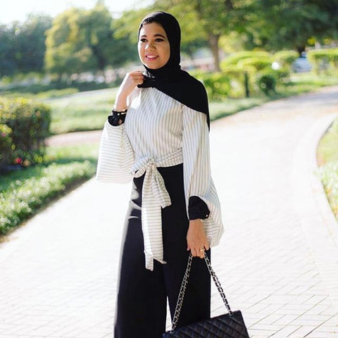 mina-al-sheikhly-striped-flare-belted-top