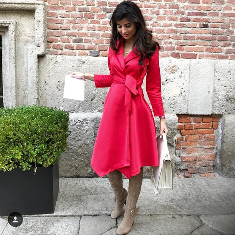 @olafarahat #Milan fashion week looking effortlessly chic in our wrap red dress ! #shop #now #ownthelooks