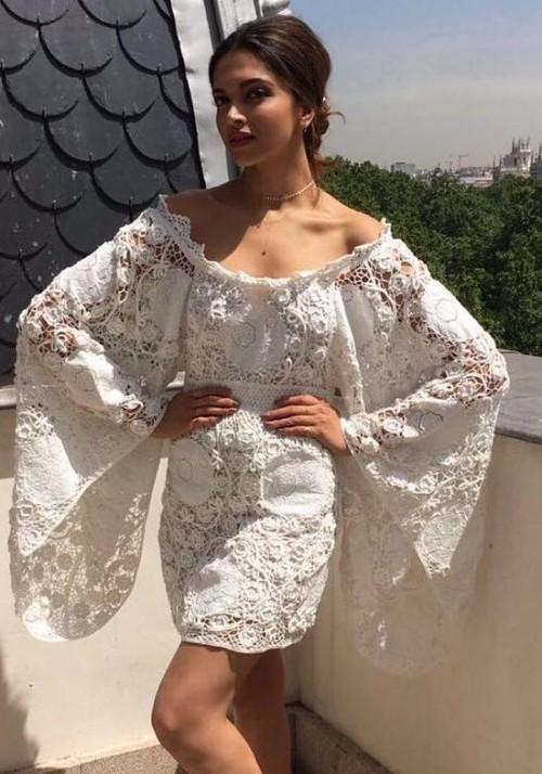 Deepika Padukone in a simple yet detailed white lace dress