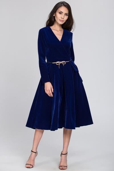 Electrify onlookers with this sumptuous blue velvet dress and delicate gold ribbon belt. Charming bow details at the waist and an A-line skirt help fit and flatter your natural figure. Long sleeves and a V-neck help balance the proportions of this look for effortless, refined style.