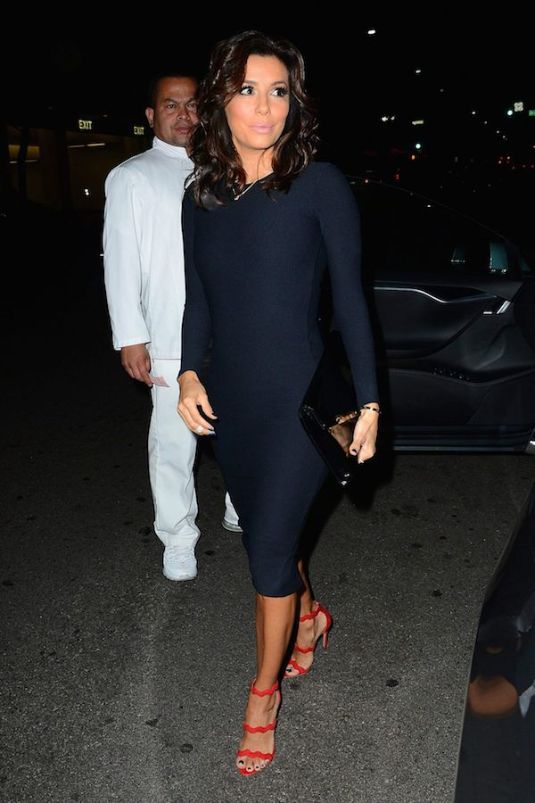 Eva Longoria Baston wears red heels with her black ensemble - you can owthelook