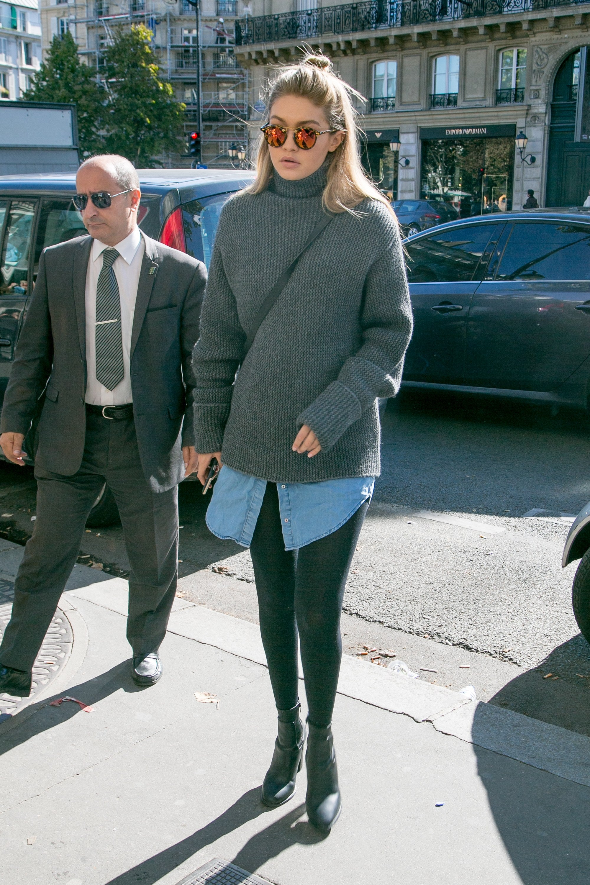 Gigi Hadid sports an over sized sweater with black pants