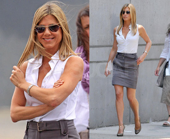 Jennifer Aniston wears a grey pencil skirt and a white top