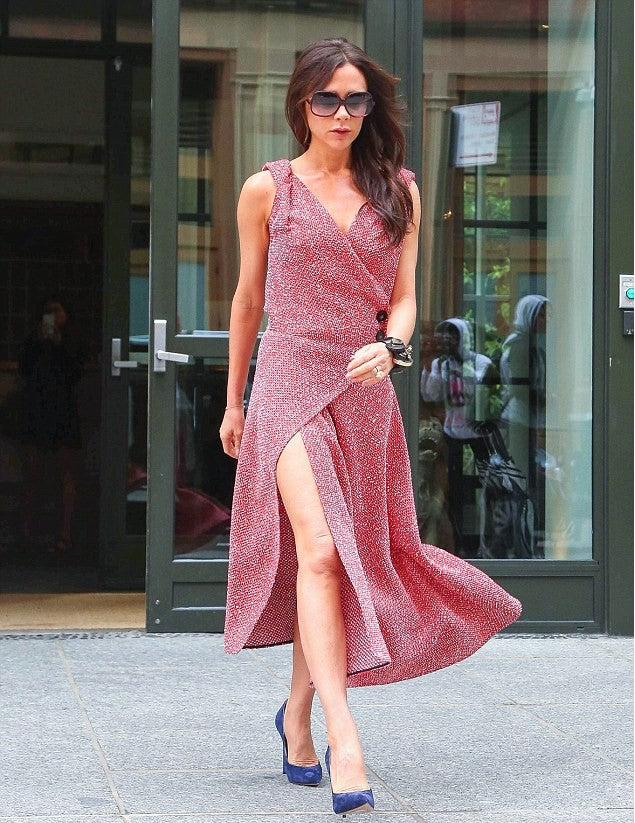 Victoria Beckham wears a Pink Shimmery Wrap around Dress