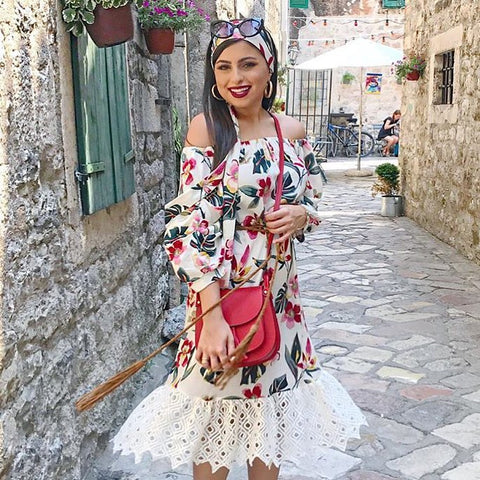 OwnTheLooks beautiful floral print midi dress features chic shoulder baring fun puff sleeves  with a long sash to encircle the waist or head. heavy lace skirt trim finish on captivating design.