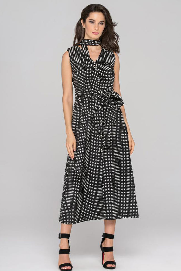 Strike a timeless silhouette in the Black Sleeveless Reverse Houndstooth Button Up Midi Dress from OwnTheLooks. Featuring a fully button-down front and tie-wrap waist, this patterned dress has the perfect balance of shape and texture. Pair yours with heels and wear the extra sash as a neck wrap accent for classic Hollywood style.