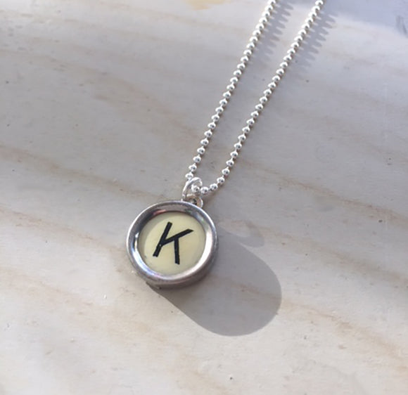 Letter K Sterling Silver Typewriter Necklace on Light Background