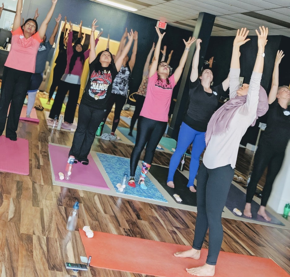 Yoga Session with Women Fundraising Sakeena Homes Work Around Workspace Toronto