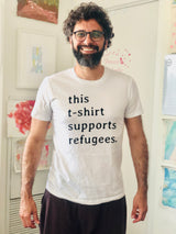"Sitti x UNHCR: ""this t-shirt supports refugees."" Unisex T-Shirt."