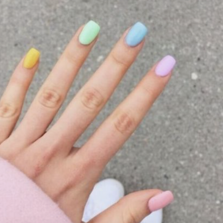 Hand with bright pastel coloured nails