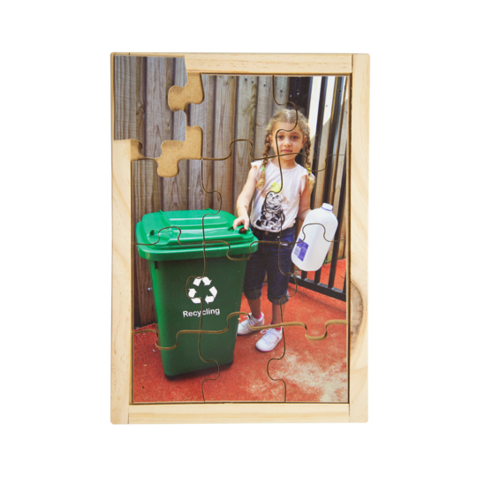 Australian-made wooden puzzle, featuring photograph of a girl disposing of a plastic milk bottle in the recycling bin. Designed for childcare.