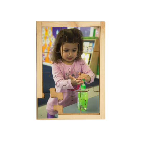 Australian-made wooden puzzle, featuring photograph of a girl displaying hygiene by using hand sanitiser. Designed for childcare.